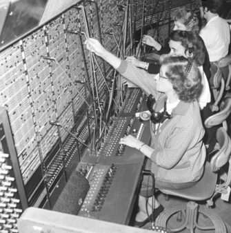 Black and white photograph of operators at a telephone exchange | Science Museum