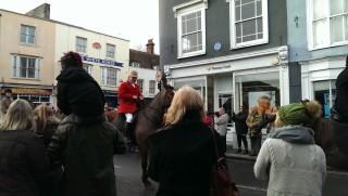 A huntsman on a horse rides up Silver Street towards the Blue Boar pub. | Stuart Bowditch