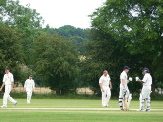 Woodham Mortimer batsmen give each other encouragement between overs.