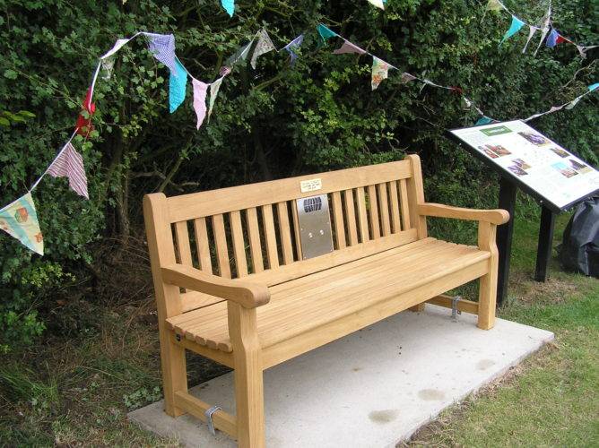 Photograph of listening bench installed on Blacksmith's Corner