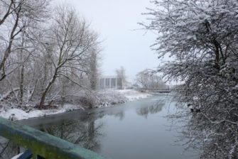 Distant view of ERO over the river in the snow | Essex Record Office
