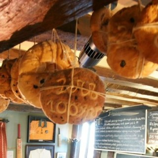 Hot Cross buns hanging from the ceiling of The Bell lnn | Image courtesy of The Bell Inn