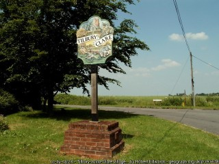 Photograph of Tilbury Juxta Clare village sign on patch of grass | Robert Edwards