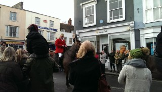 A huntsman on a horse rides up Silver Street towards the Blue Boar pub. | Stuart Bowditch