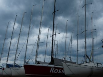 Photograph of boat masts against a dark sky | Hans