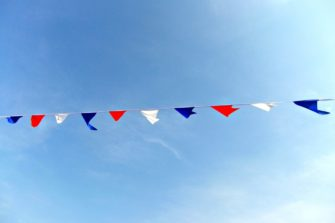 Photograph of bunting against blue sky | ziggy2012