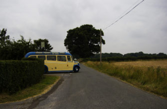 A 1950 Bedford Duple OB pulling away from The Compasses pub in Pattiswick with some wedding guests aboard | Niki Cornish