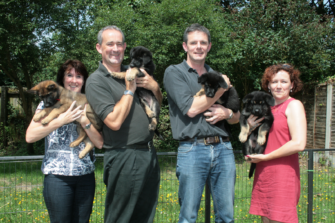 Photograph of volunteers holding puppies | Essex Police
