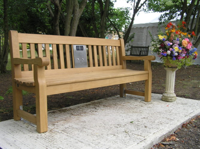 Photograph of bench installed at Centre with pot of flowers